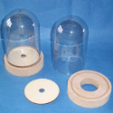 Small Dome Bell Jar of Clear plastic, on MDF Stand, with foot plate, as shown. Hole in base suitable for fitting lights.