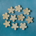 Pack of 10 natural Wooden Flower shapes with embossed pattern, & self adhesive pad