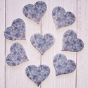 Pack of 8 blue floral heart shape embellishments with self adhesive pad