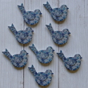 Pack of 8 blue floral bird shape embellishments with self adhesive pad