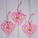 Set of 3 pink heart hanging decorations with floral design & bell