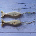 Set of 2 wooden Fish Shapes with carved details, metal hook and natural string to hang