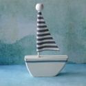Wooden sailing Boat, as shown, with striped fabric sail, standing decoration