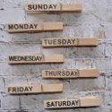 Set of 7 Wooden Pegs, with printed days of the week