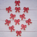 Pack of 12 wooden Bows painted red, as shown with self adhesive pad