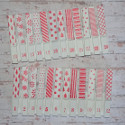 Set of 24 numbered Advent pegs with red & white patterns, as shown