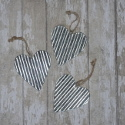Set of 3 small corrugated metal hearts with string to hang